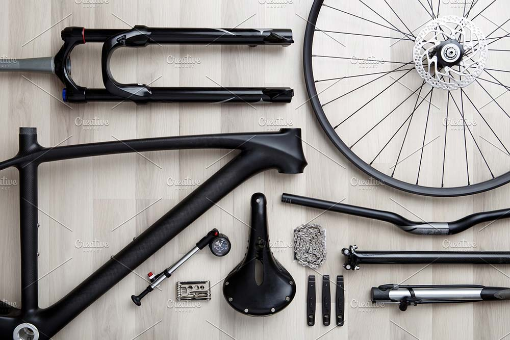 Photo of bicycle objects on wood