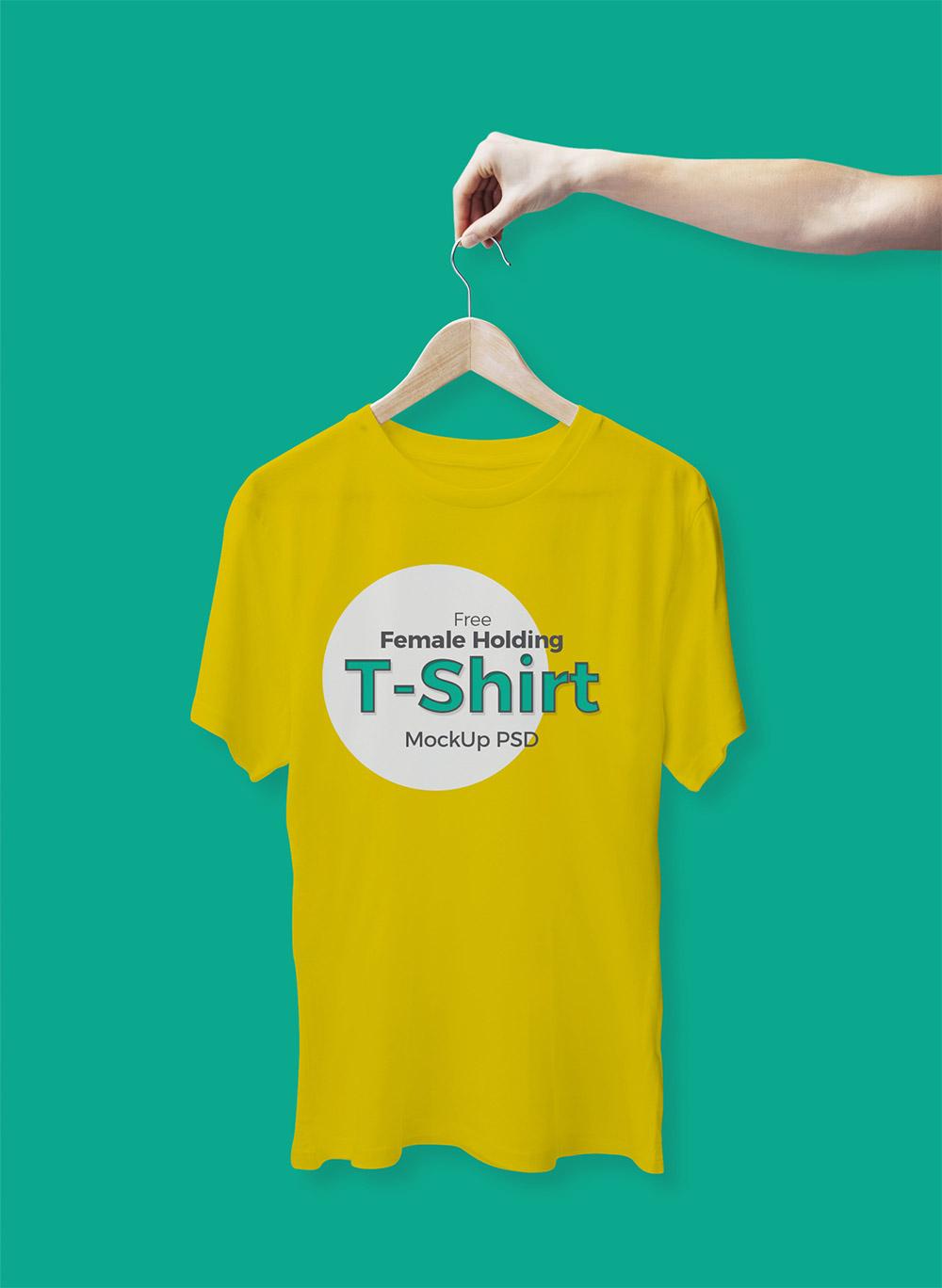 Free Female Holding T-Shirt Mockup