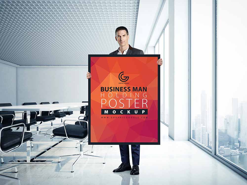 Free Business Man Holding Poster Mockup