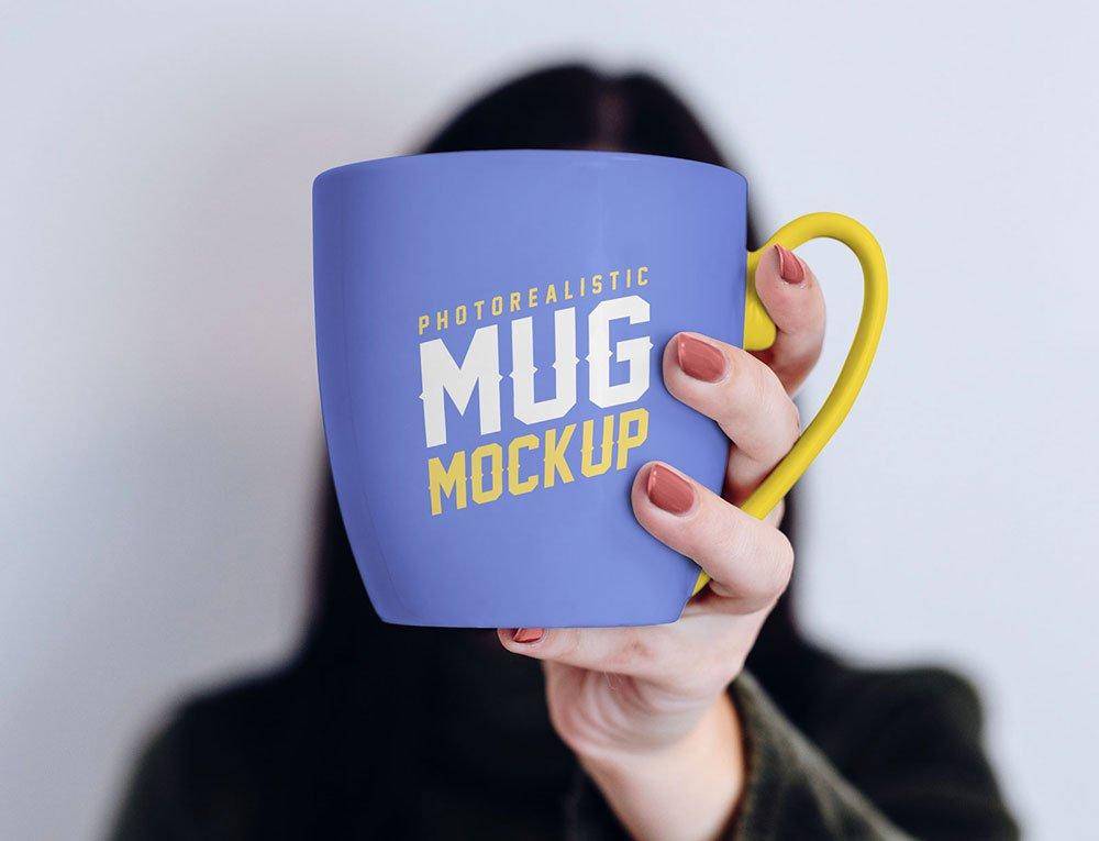 Free Mug in Hand Mockup