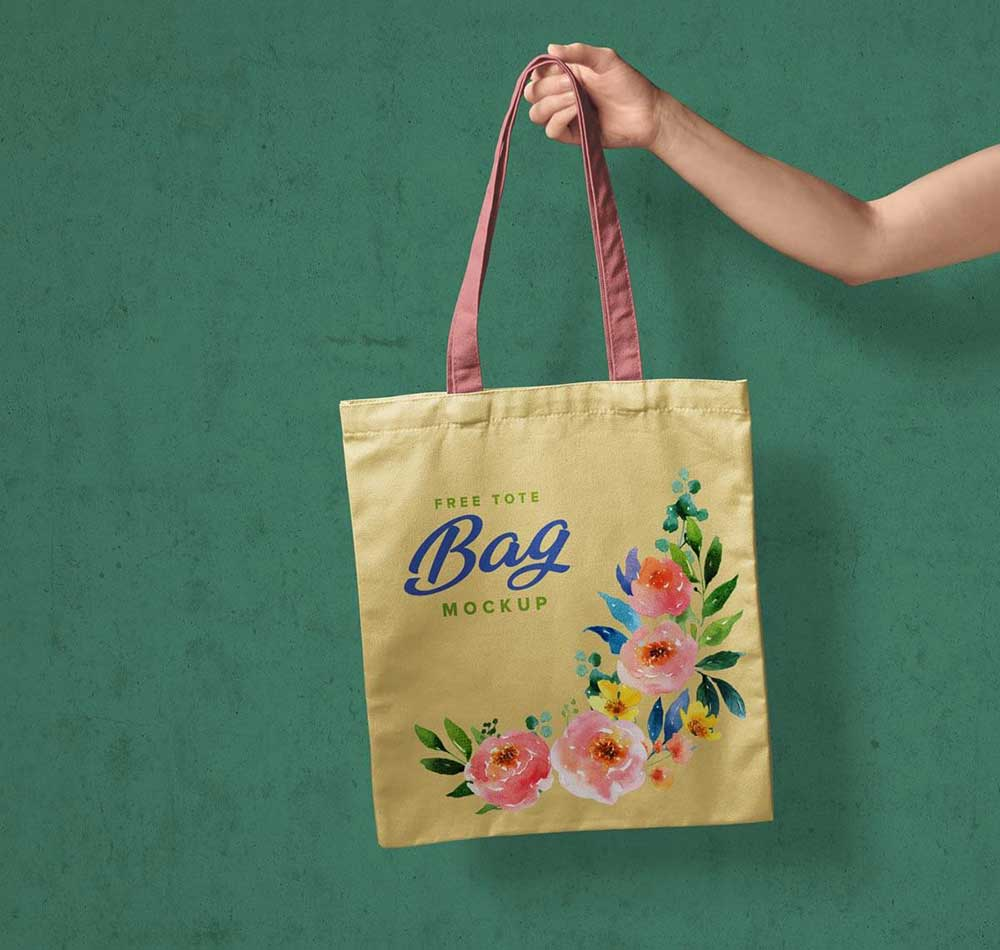 Free Hand Holding Tote Bag Mockup