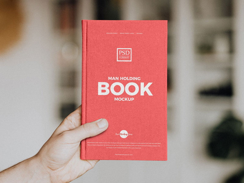 Free Man Holding Book Mockup